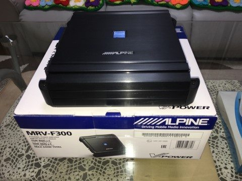 Alpine MRV-F300 amp on top of its package