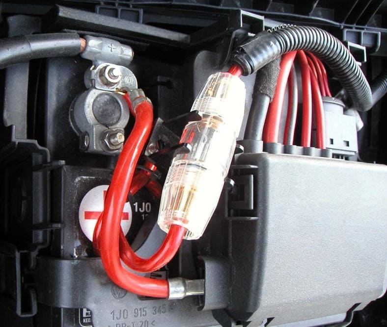 Car amplifier positive wire and fuseholder installed at battery