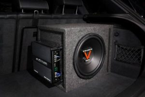 Car amp mounted to subwoofer box