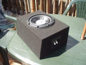 Image of subwoofer being mounted in box