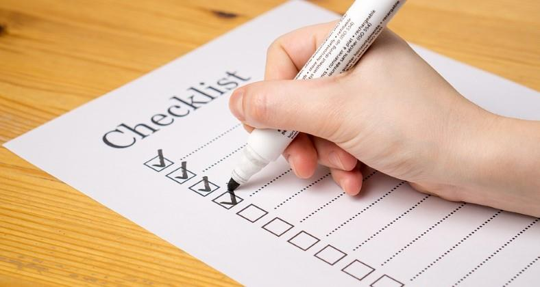 Image of a paper checklist being prepared with a marker