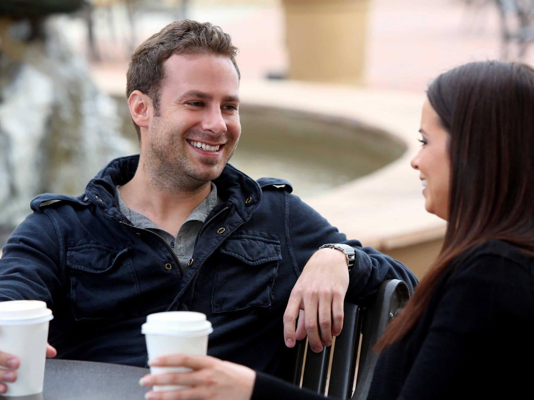 Image of confident guy talking to woman